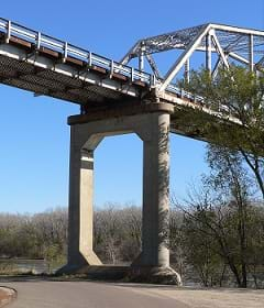 The concrete pier of a bridge crossing the Missouri River between Decatur, Nebraska and Monona County, Iowa.