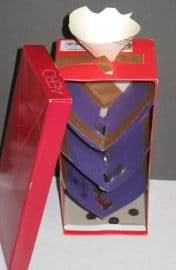 Photo shows a shoe box standing up vertically, with a funnel opening cut through the top and cardboard levels taped inside the box with variously-sized holes, and coins caught at every level.
