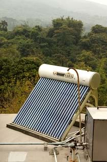 A solar water heater mounted on a roof.