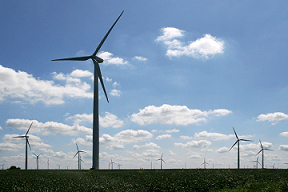 A landscape photograph shows a field of tall wind turbines in northwestern Benton County, IN.