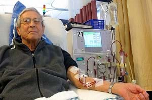 A photograph shows a man in a hospital bed connected to a dialysis machine receiving dialysis.