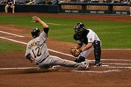 A baseball player sliding into home plate.