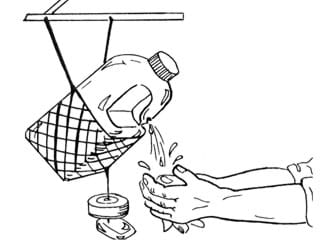 Line drawing shows a tipping plastic jug of water hanging in a net from a support above it, with a pair of hands washing under water dripping from a hole in the curved jug handle.
