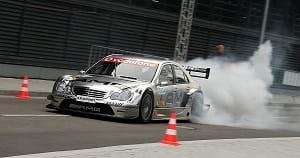 A Mercedes-Benz DTM car driven on a race track.