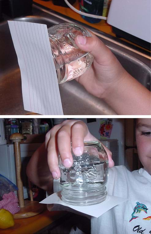 Photographs showing an index card securely fastened on the top of an upside down and horizontal jar filled with water.