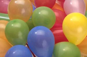 A photograph of a mass of colorful blown-up plastic balloons.