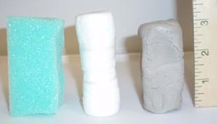 Photo shows columns of foam, marshmallows and clay lined up by a ruler, so you can see their 3-inch heights.