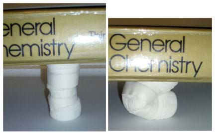 Two photos show a marshmallow column (left) at full height, and (right) broken and compressed under the weight of a book.