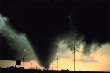 A photo showing a severe tornado in Texas with a close-up shot of the tornado's cone.