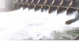 A photograph shows rushing water flowing through a dam.
