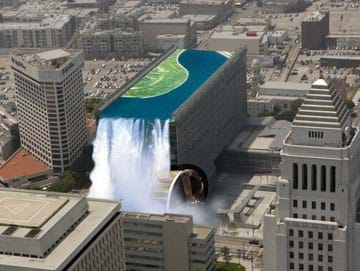 A fanciful aerial image shows what it would look like if a skyscraper topped with a water reservoir spilled over one edge of the building, turning a huge waterwheel, in the middle of a city.