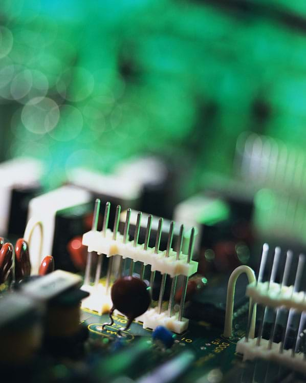 Photo shows close-up of pins in a circuit board.