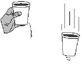 A simple line drawing shows a hand holding a cup full of a liquid with a dribble of liquid draining out of a hole in a cup. A second drawing shows the same cup full of liquid falling through the air, with no liquid draining out of the hole.