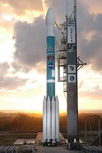 A photograph shows a rocket poised, nose up, on a launchpad.