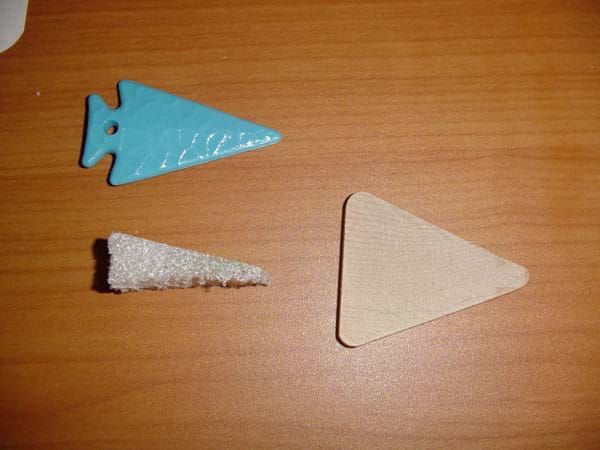 Photograph of three triangular-shaped items.