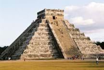 Photo shows a huge stone pyramid with many steps and a flat top.