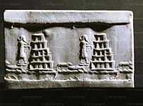 Photo of a stone with images of people, animals and stacked pyramids.