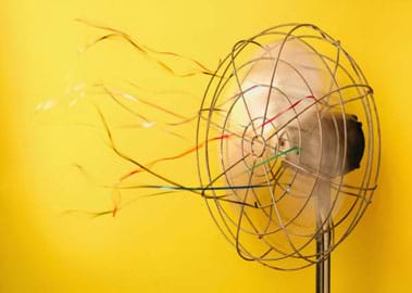 Photo shows fluttering ribbons tied to a spinning fan.