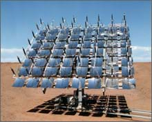Photo shows 56 concave mirrors forming a panel mounted on a stand in the sunny desert.