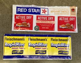 A photograph shows six packets of active dry yeast, two brands: Red Star and Fleischmann's.