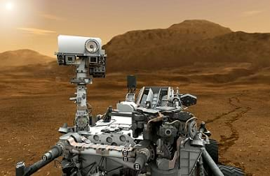An artist's illustration shows a robot on wheels with a camera and sensors on the red-soil surface of Mars.