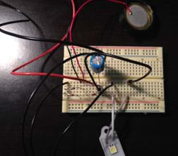 The same breadboard as figure 6, now with an LED light bar connected.