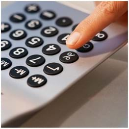 Photo shows a keypad with a person's finger about to press on a button.